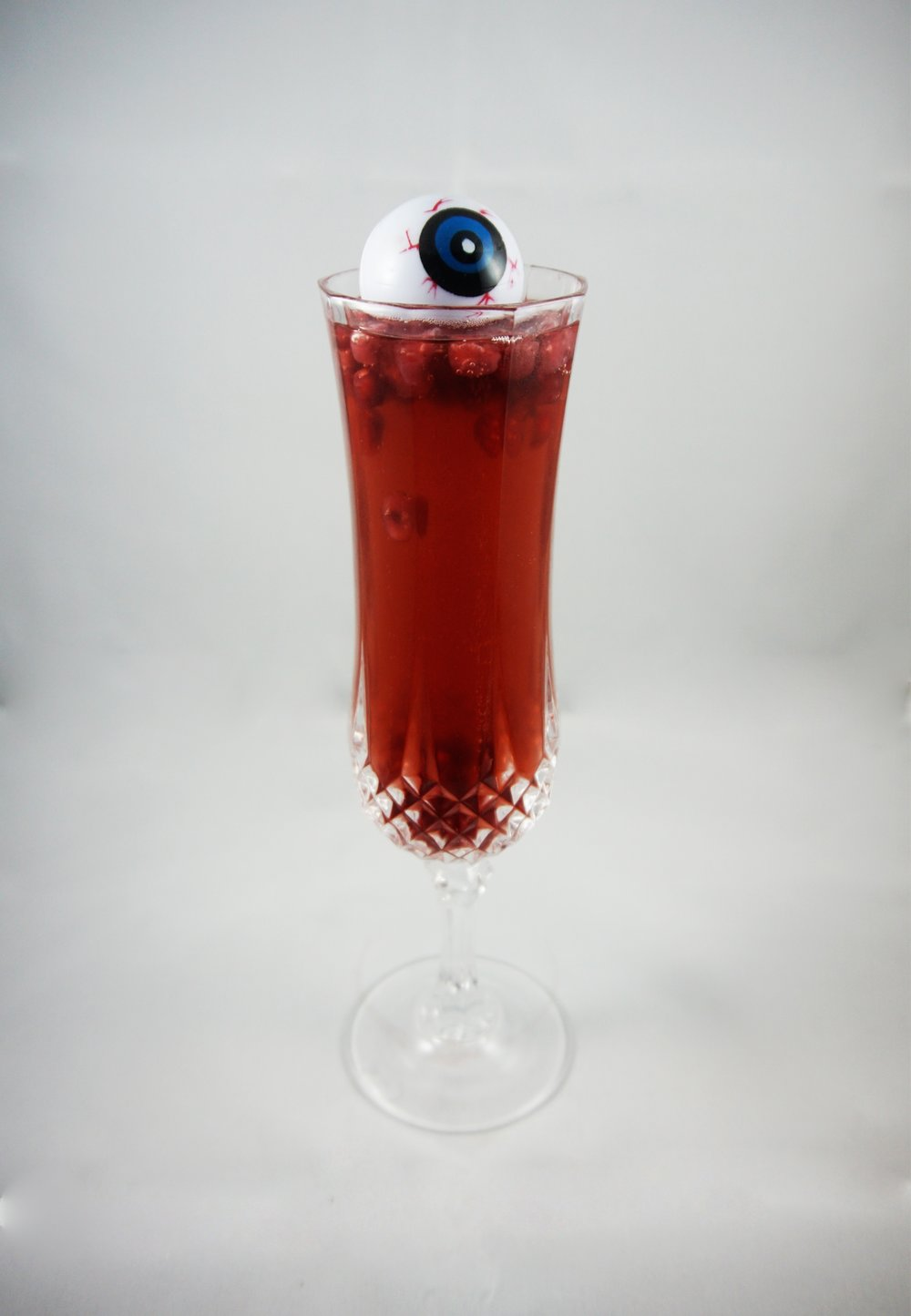 Better Watch Out (2017)   - ChampagneRaspberry liqueurCranberry bittersPomegranate seeds Pour raspberry liqueur, pomegranate seeds, and cranberry bitters in glass. Top with champagne. No exact measurements needed - just eyeball it.