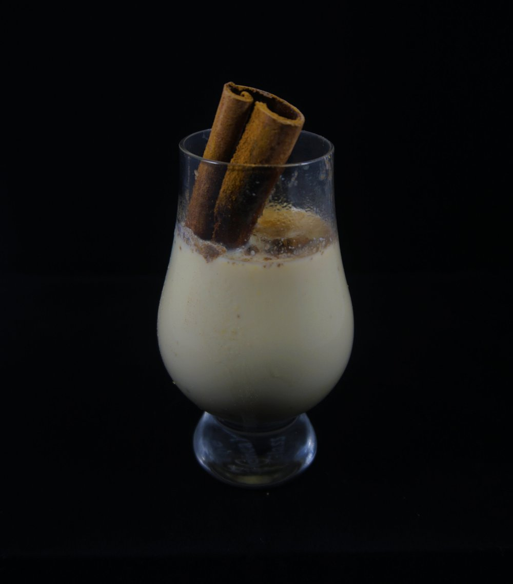 Afterhours   - 1 15.25oz can of sweet corn2 cups whole milk2 Tlbs of sugarPinch of kosher saltCinnamon stick3oz amaretto0.75oz arakkuGround cinnamon, to tastePurée corn and 2/3 cup of milk. Transfer to pot and add remaining milk, sugar, salt and cinnamon stick. Bring to boil and simmer 2-3 minutes. Strain. Return to pot and stir in amaretto and arakku. Top with ground cinnamon, to taste.