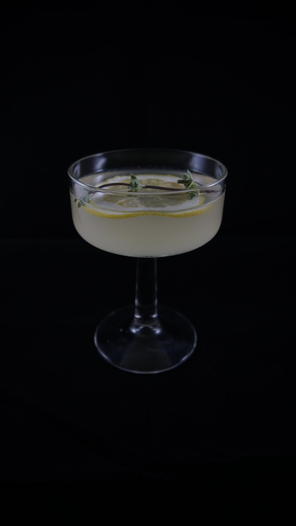 Suspiria (1977) - .75 oz Sambuco.75 oz Lillet blanc.75 oz Elderflower liquor.75 oz Lemon juiceDash of ginLemon twist for garnish Combine all liquids in a shaker with ice. Strain and pour in tall glass. Add lemon twist for garnish.  For extra botanicals on the nose, add a sprig of fresh herbs (here we used fresh marjoram).