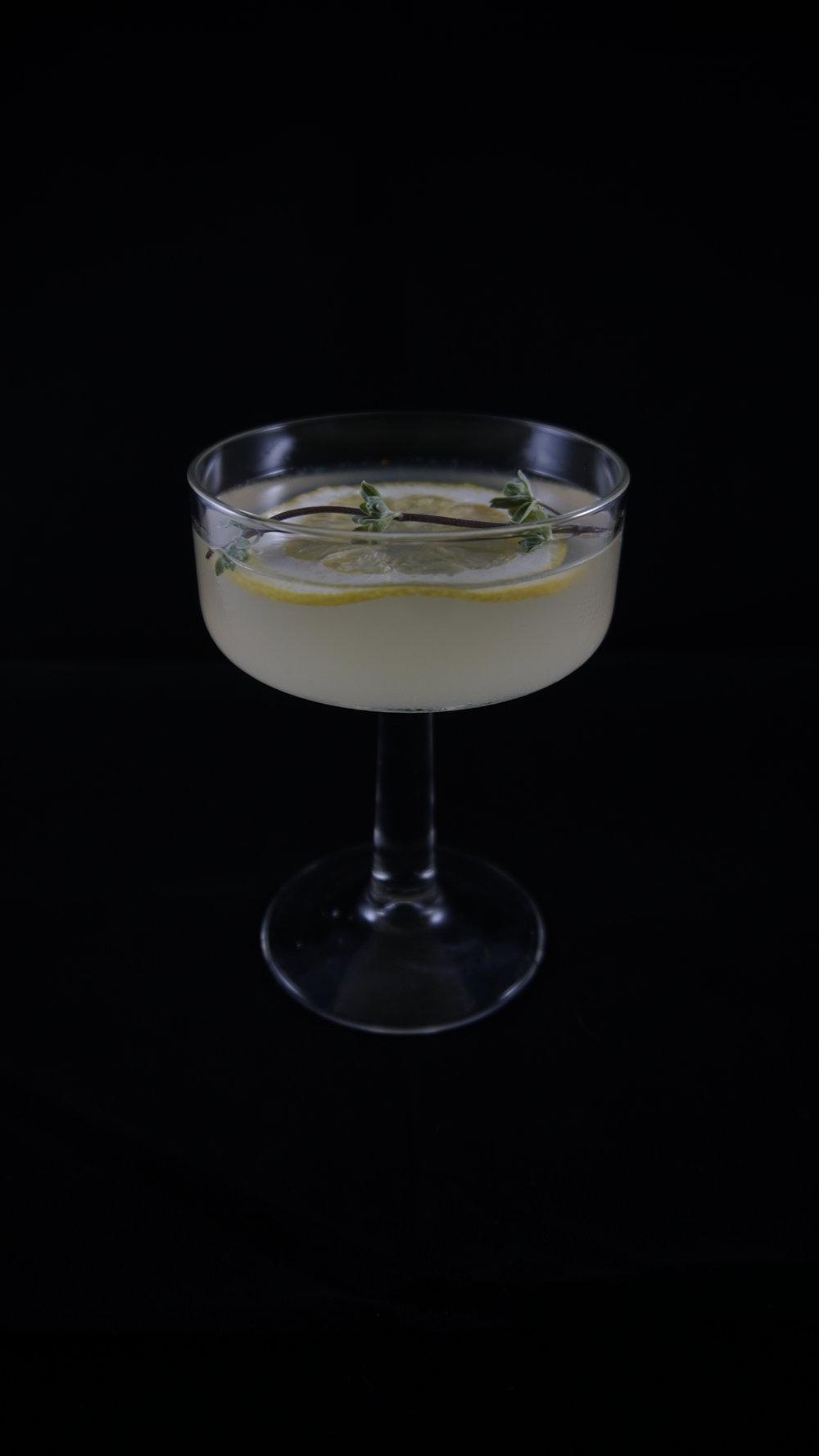 Suspiria (1977) - .75 oz Sambuco.75 oz Lillet blanc.75 oz Elderflower liquor.75 oz Lemon juiceDash of ginLemon twist for garnishCombine all liquids in a shaker with ice. Strain and pour in tall glass. Add lemon twist for garnish.For extra botanicals on the nose, add a sprig of fresh herbs (here we used fresh marjoram).