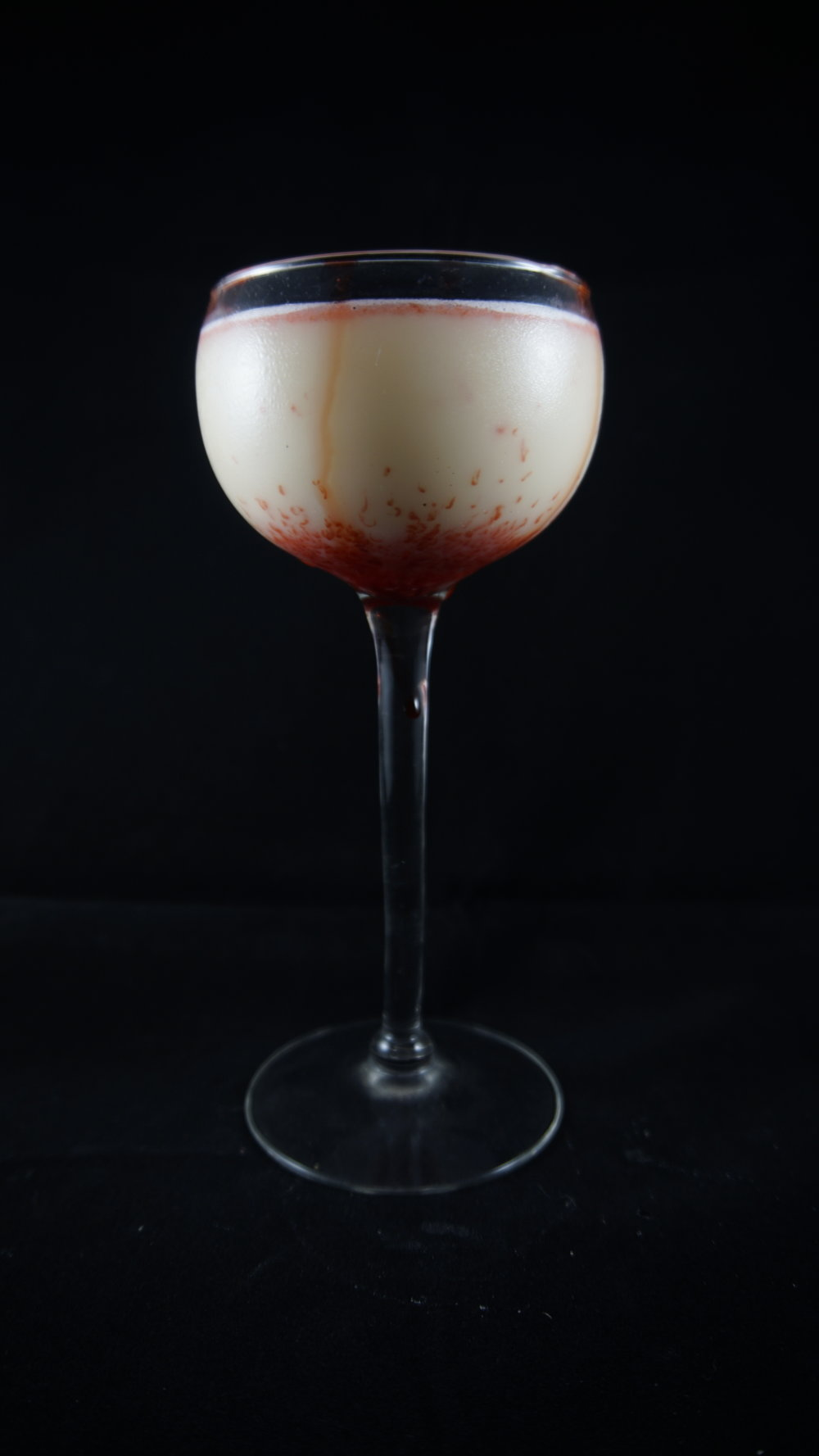 Leviticorpse - 2 oz Deaths Door vodka2 oz white amaretto1 oz creme de menthe1oz branca mentadash of cranberry bittersCombine the vodka, creme de menthe, and branca menta in shaker with ice and shake well. Pour in glass and top with a few shakes of cranberry bitters.