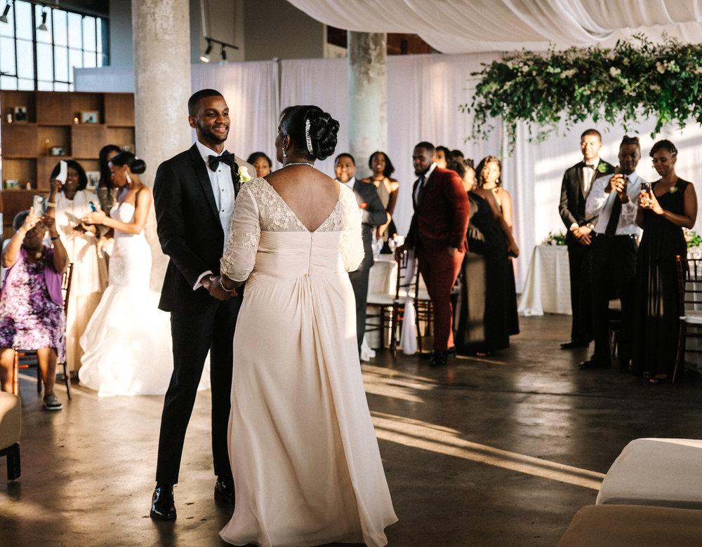 The Lofts at Union Square, High Point, NC. Wedding Reception Photos, Mother and Son Dance Photos. North Carolina Wedding Photographer, Marina Rey Photography.