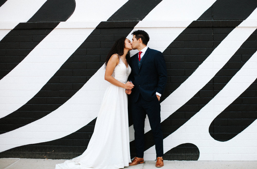 Black and white mural | Utah wedding photography, Salt Lake City Wedding Photos | Unique wedding photo | Candid kissing wedding photo | Bright, colorful wedding photography | Marina Rey Photography