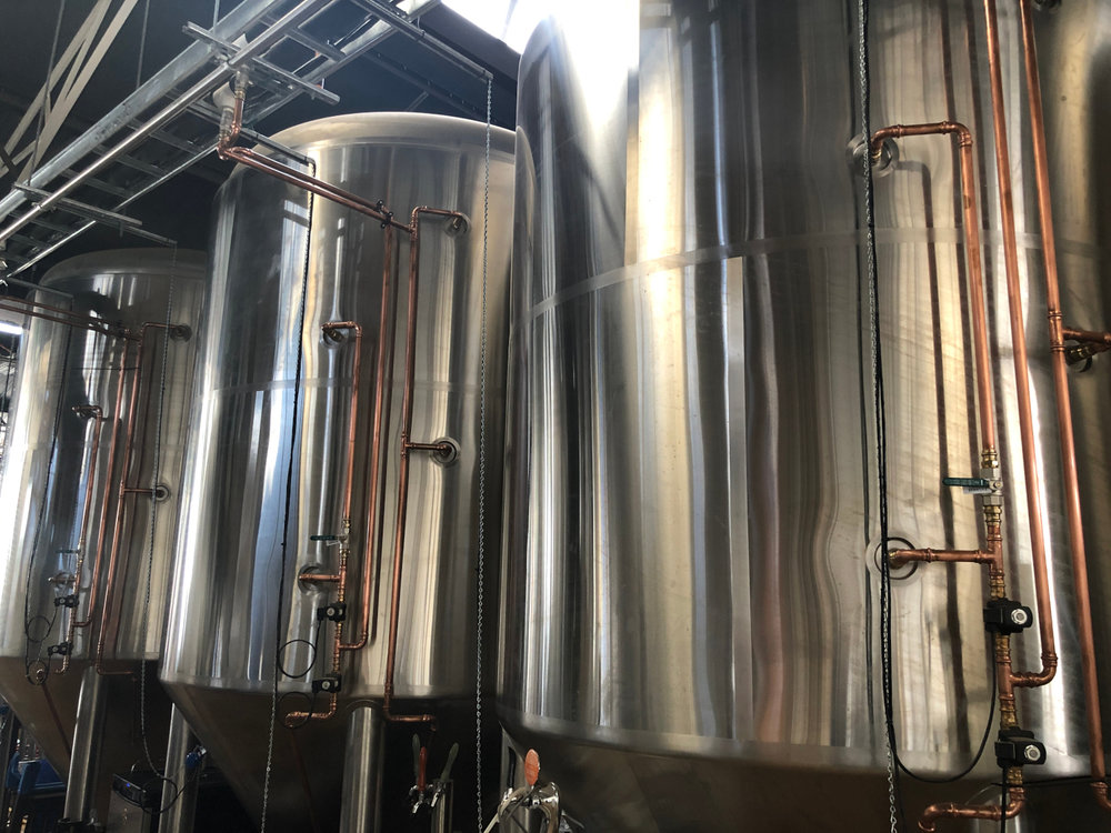 Deeds Brewing Tanks with all copper pipes connected and ready for glycol.