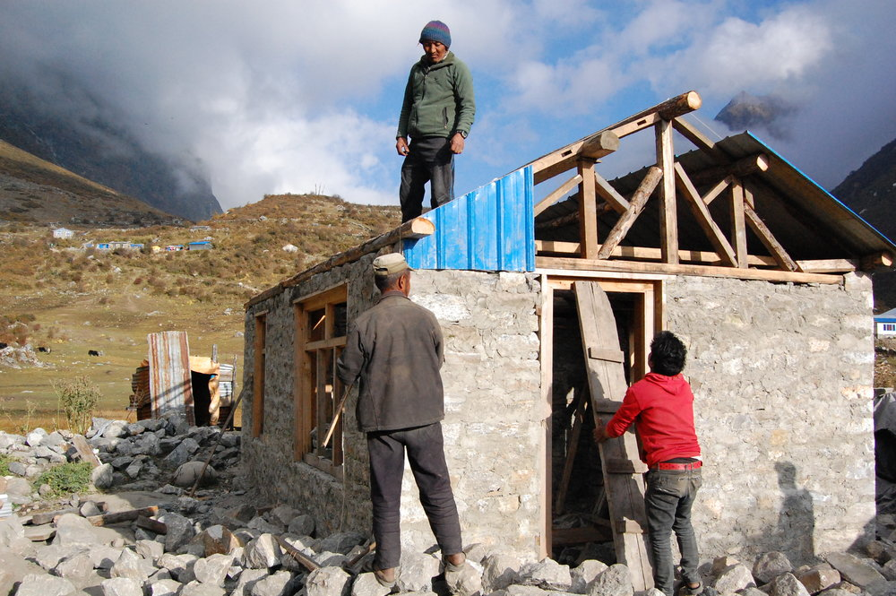 Three Nepali men build a new stone house in Langtang Valley, November 2016