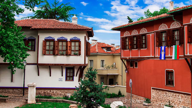 Three colourful, traditional Bulgarian houses in the Revival style, in the town of Plovdiv