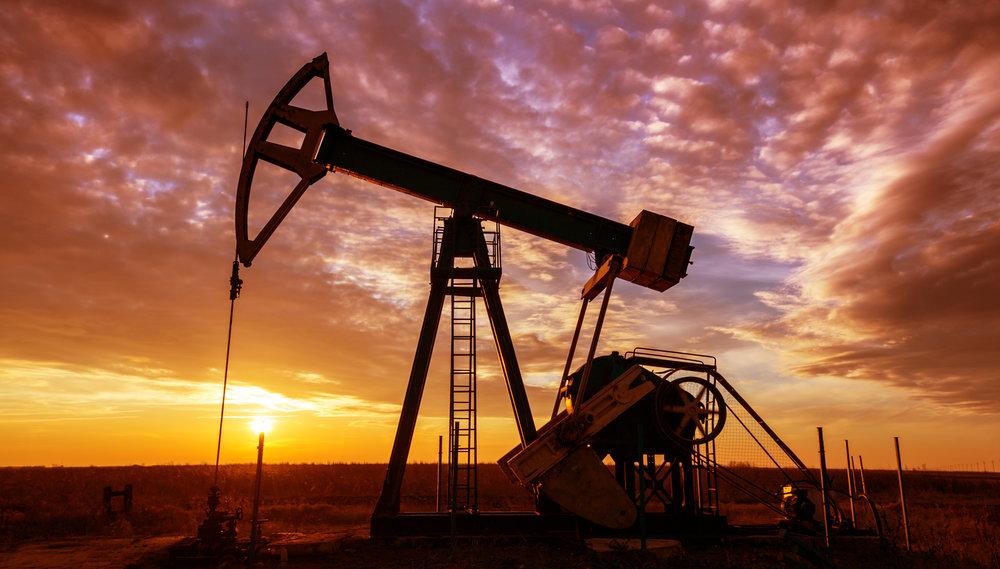 Oil derrick at sunset - EDR Geophysical Consultants
