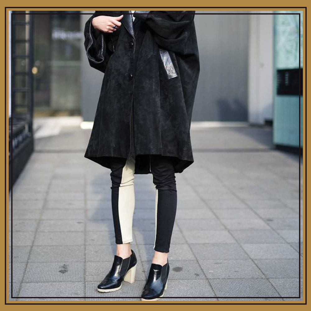 When the outfit takes a more subdued approach to color, interest is created by  playing with proportions  and incorporating  unexpected textures . This oversize and intentionally ill-fitted suede coat does both of those things, and it finds footing with  statement black leather shoes .