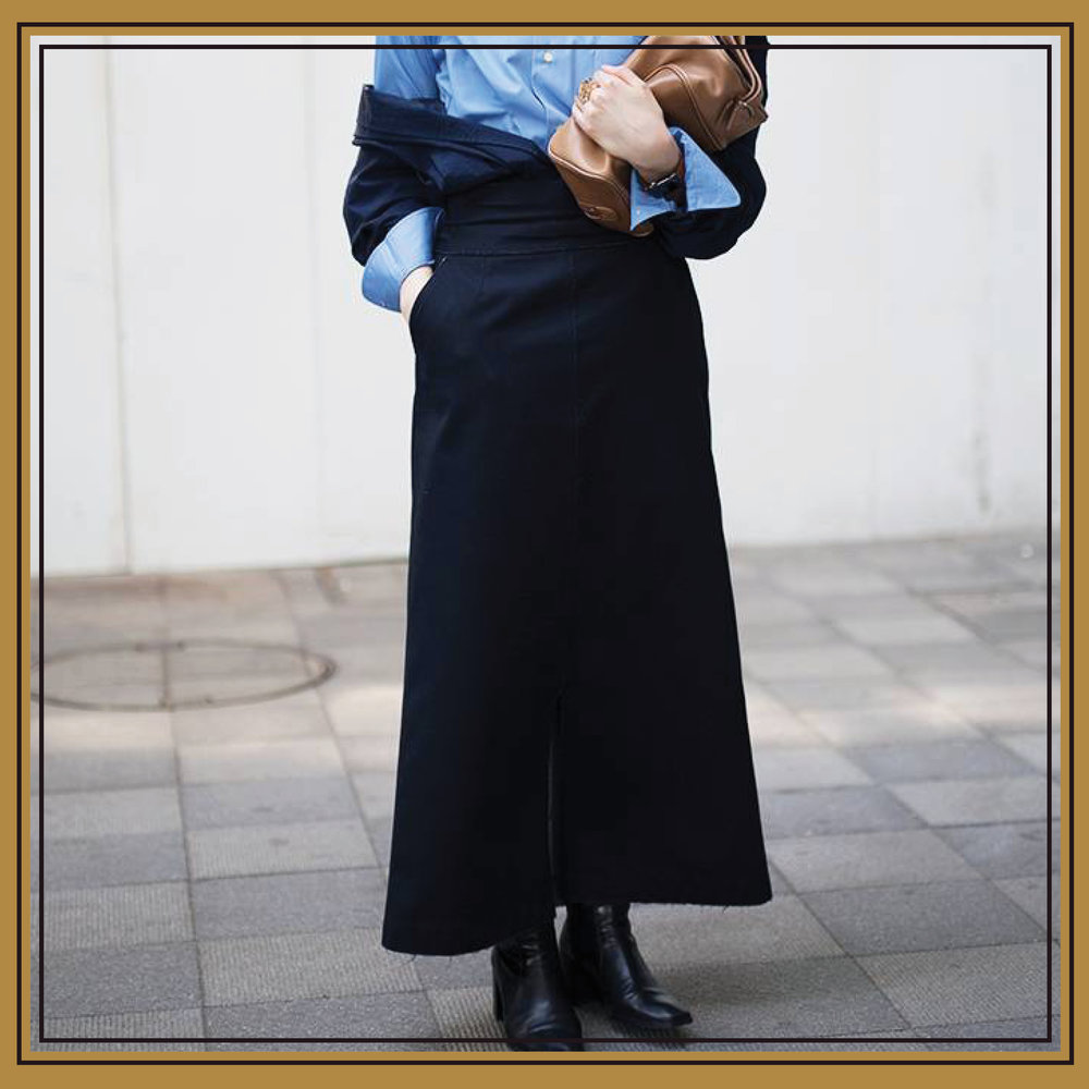 This  maxi skirt  and button-down pairing is made inimitably chic with an off-the-shoulder jacket, and  black leather ankle boots pare down the entire ensemble .