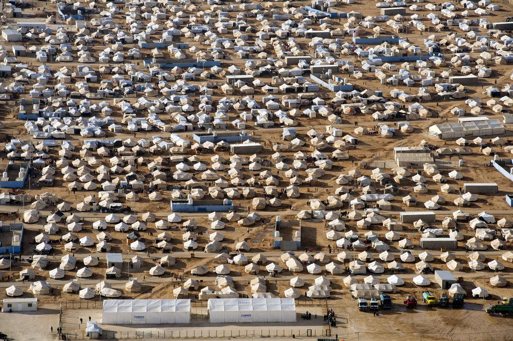An aerial view of Za'atri refugee camp, host to tens of thousands of Syrians displaced by conflict, near Mafraq, Jordan. 07 December 2012 I Mafraq, Jordan  © UN Photo/Mark Garten