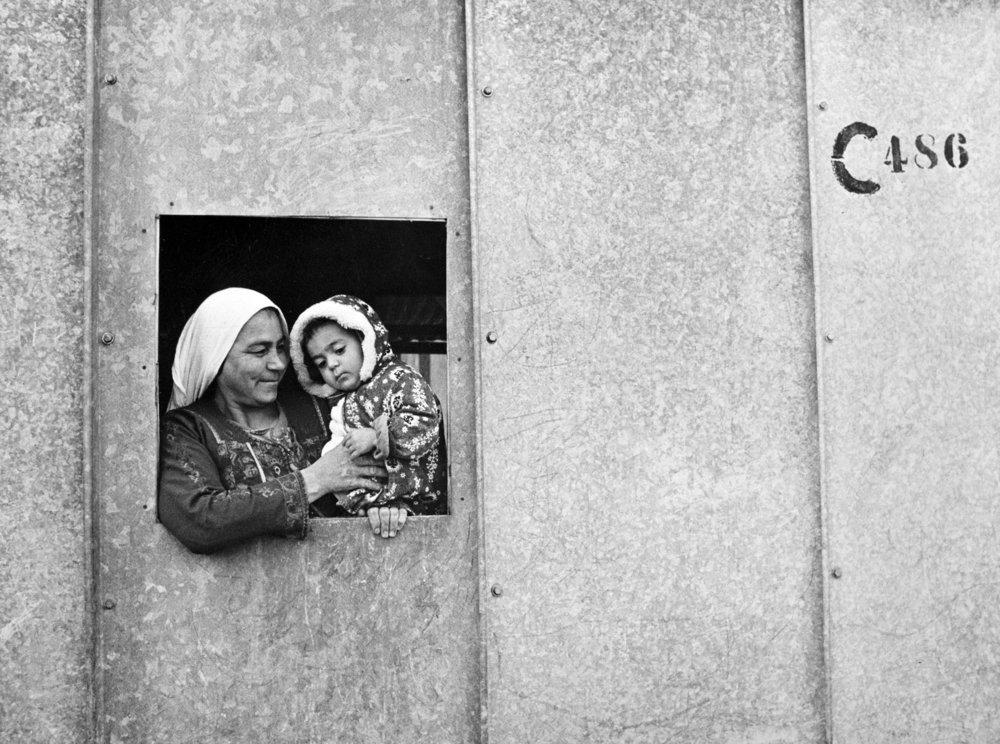Members of a Palestine Refugee family at the Baqa's camp near Amman, East Jordan. 01 January 1977 I Amman, Jordan  © UN Photo/George Nehmeh