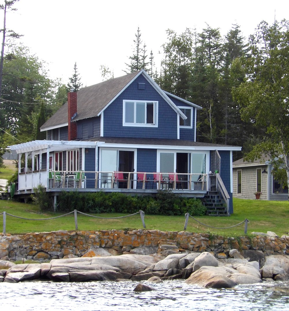 The house - The Dunbar is 1,350 square feet with an open floor plan and panoramic views of the water. The main floor includes the kitchen, eating area, sun room, and living room with gas fireplace and access to expansive deck.