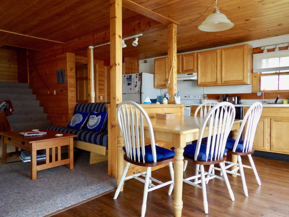 1st floor - Living Room with Gas Fireplace and Double Futon Couch • Eating Area • Kitchen • Master Suite with King Bed • Full Bath • Sunroom • Large Deck on the Water • Laundry