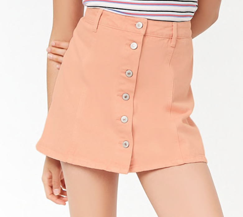 Peach Denim Skirt - A refreshing pop of color in an otherwise black-and-white ensemble.
