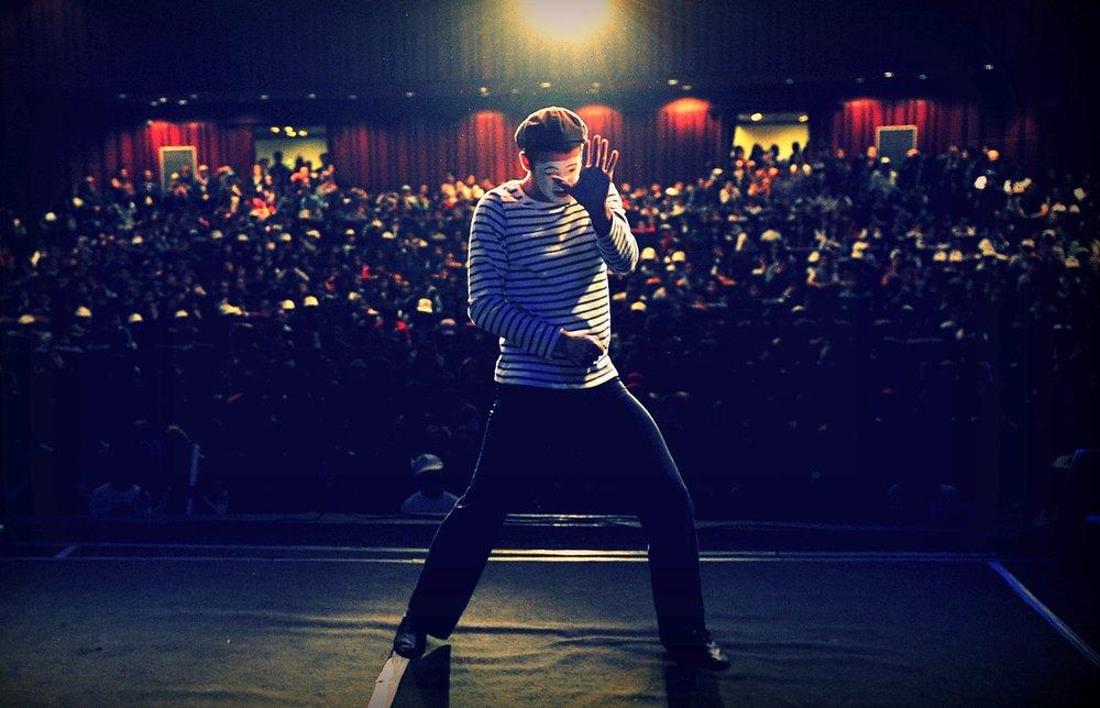 A man on stage. Photo by  Fatih Kılıç  on  Unsplash
