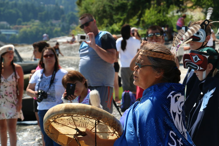 The Stz'uminus First Nation sings canoes ashore in Chemainus, B.C. in 2017.  Photo credit: Julian Brave NoiseCat