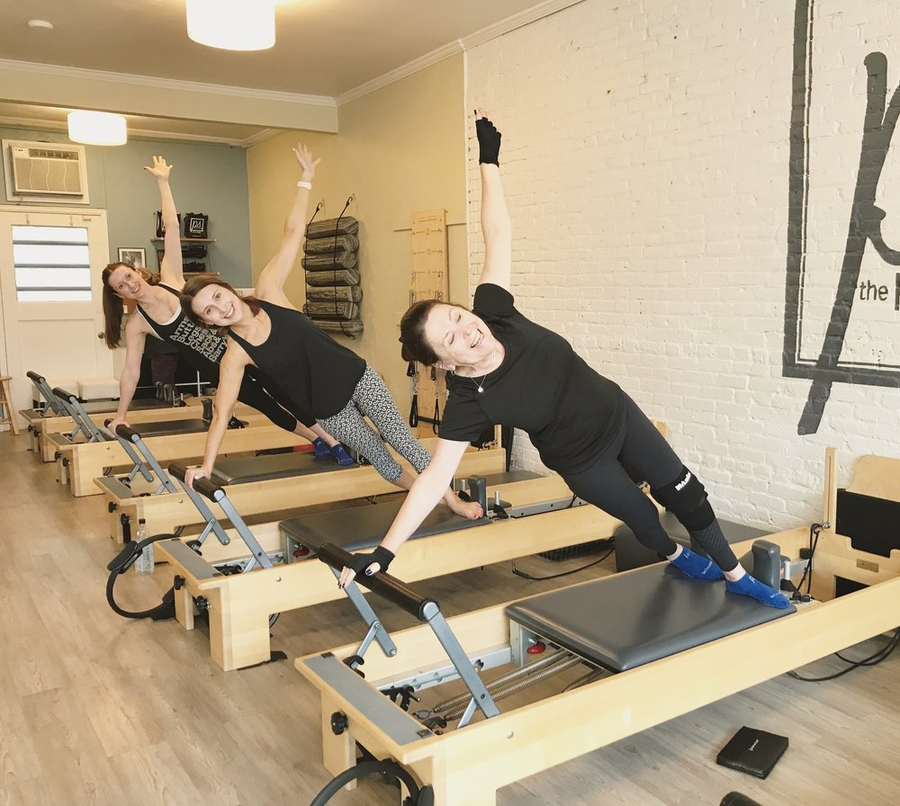 Side plank on the Pilates reformer | Why I Practice Pilates