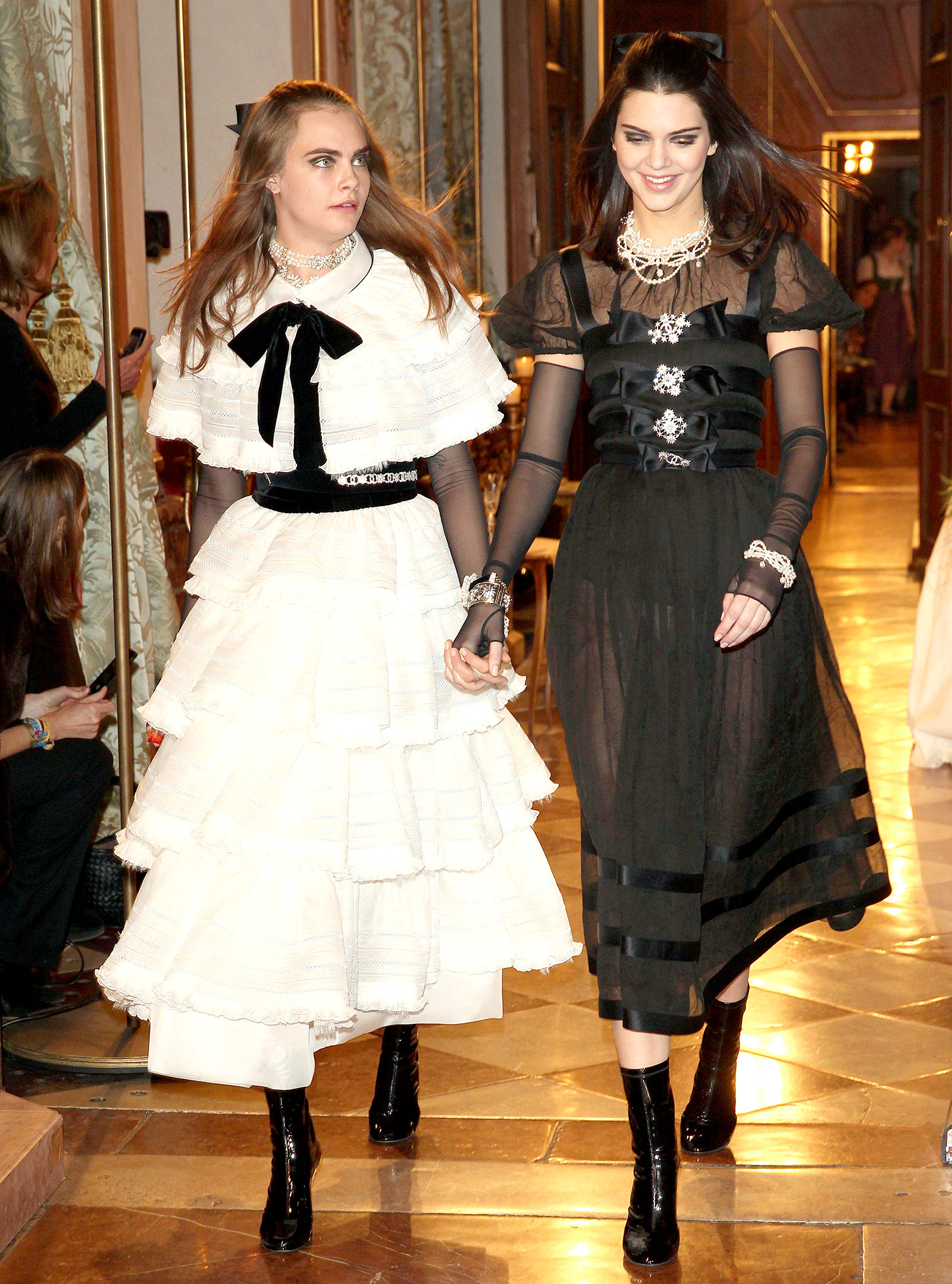 Kendall Jenner and Cara Delevigne walking in the Chanel runway show.