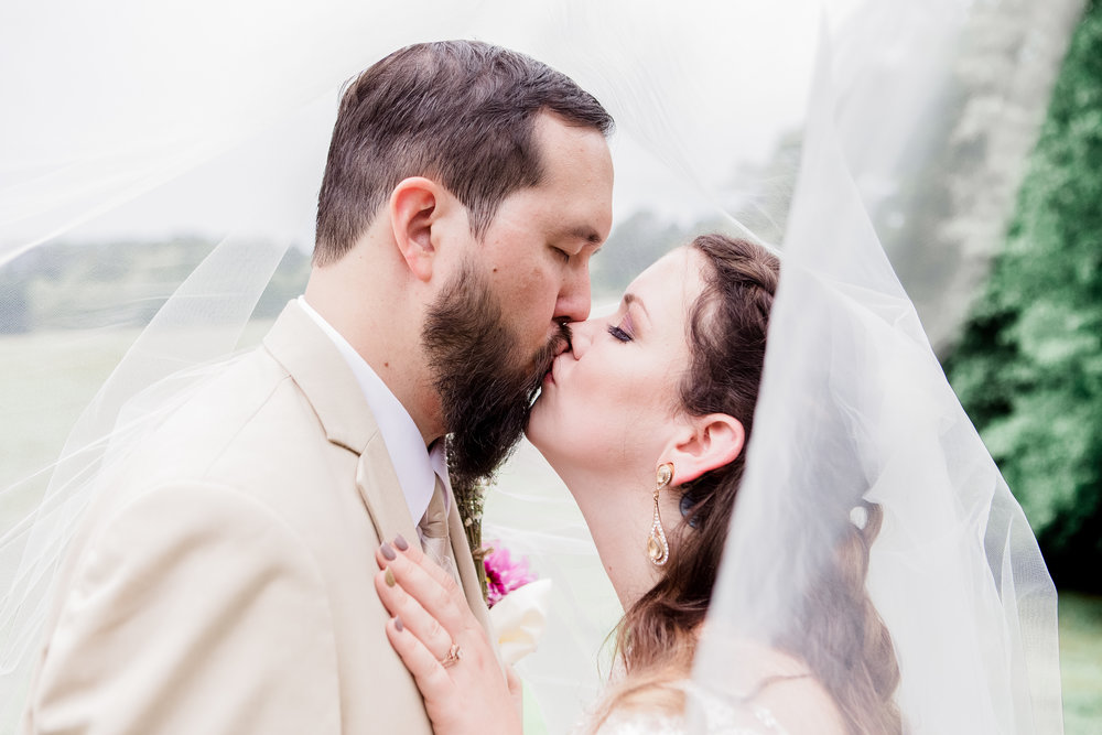 bride and groom kiss under veil Atlanta georgia.jpg