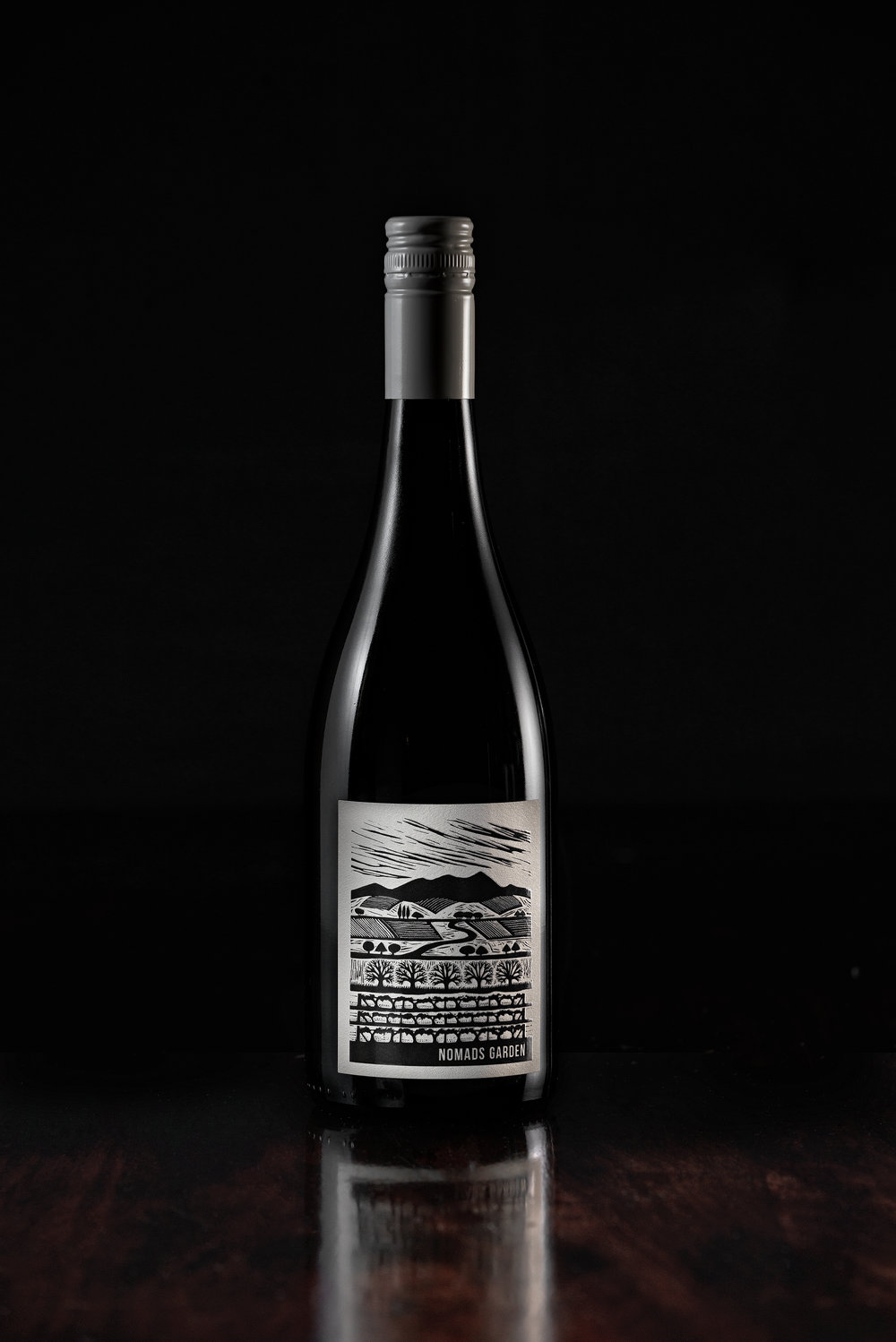 "2018 pinot noir - Handmade - Hand Plunged - Basket Pressed - Wild Yeast Ferment - Unfined  - No Acid Added - Barrel Aged on LeesVineyard ~ Greenacres Vineyard, Alpine ValleysSourced from one of the most passionate salt of the earth growers we know in Brian ""Bri"" Llewis from his spectacular Greenacres Vineyard in Merriang South. This vineyard is deep in an isolated valley of the sprawling Alpine Valleys GI and such a cool site it is not unusual for it to snow there a couple of times over the winter period.As with all wines released under the Nomads Garden range input from us in the winery was kept to an absolute minimum. Instead careful attention was paid to working closely with Bri and ensuring the grapes were picked at exactly the right moment to ensure the natural pH and the flavours were just right.This is a pilot run, a very promising one at that. The goal, to make a good Pinot Noir from North East Victoria that actually looks like a Pinot. Only 700kg of fruit was available to us in 2018, although it was of a very high quality. Unlike may Pinot vineyards in the North East this is a Vineyard dedicated to growing fruit for table wine not sparkling base, this means it is cropped at much lower levels. Handpicked at daybreak with a baume of 12.8. Destemmed not crushed with 15% whole bunches added to the ferment, the grapes were protected under CO2 prior to the natural wild yeast fermentation commencing 3 days later. No pump overs or plunging where done as we didn't want the wine to become over extracted. Instead once a day we used our hands to lightly push the cap down and wet it. A short 15 days on skins before gentle basket pressing to a single 5 year old French oak Puncheon. Oak of this age will impart very little, if any oak characteristics instead we believe they are the best vessel for wines to ferment and age in. Oak is a natural living product that allows the wines to breath and evolve with time, something not possible with tanks.The Pinot Noir then spent 12 months in oak on full lees (lees are the solids that drop and of the wine post fermentation) to build texture. The wine was then lightly filtered and bottled, before been given at least 3 months post bottling to settle. We believe this be a promising start to what will hopefully become staple of the Nomads Garden range."