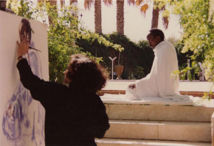 Halla painting Al Tahiyat, at the Artists' home in Riyadh, 1992