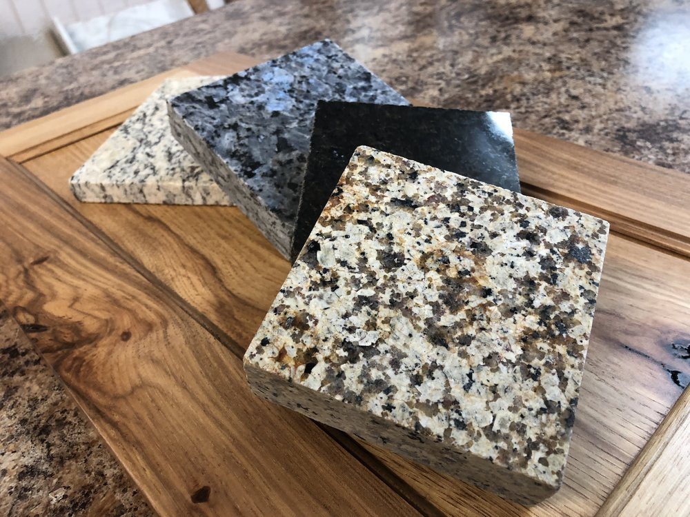 Granite - Granite countertops have a long reputation as high quality surfaces perfect for kitchen, bath, and furniture settings. Available in a wide variety of colors, there is almost certainly a stone out there that is exactly what you are looking for.Price Range: $$$$More Information: Click Here or Contact Us