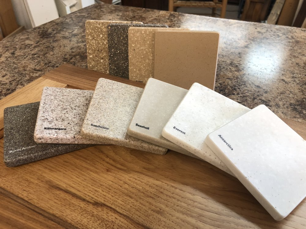 Solid Surfaces (Corian) - Solid surfaces such as Corian and similar products are synthetic materials that offer a wide array of color options. Visit our showroom to discover the bountiful color palate of this popular material. Price Range: $$$$More Information: Contact Us