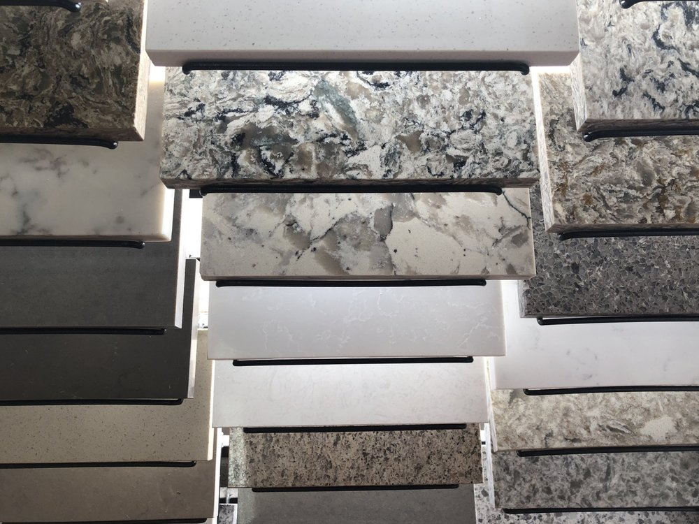 Quartz - Quartz, also known as man-made or synthetic granite, is a high durability surface material while closely maintaining the natural look of stones such as granite. This high quality material is a growing favorite, and we have many samples in stock at our showroom. Price Range: $$$$$More Information: Contact Us