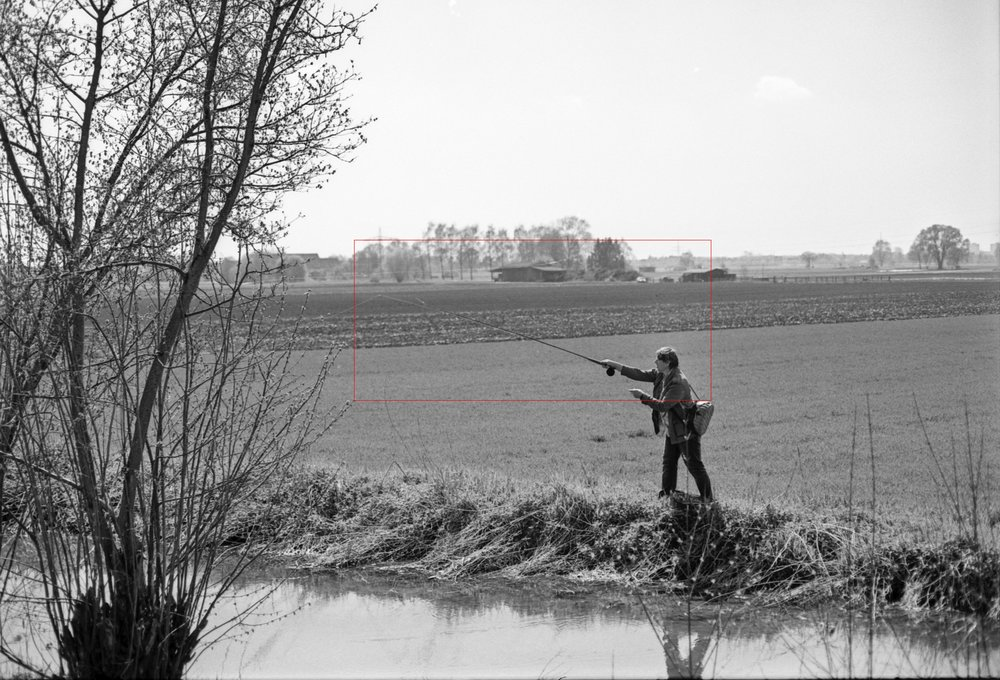Fly fishing. With ISO 25. The red rectangle shows the crop in the next picture.