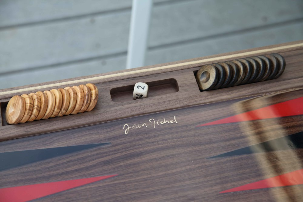 Solid Olivewood playing checkers perfectly complement the board.