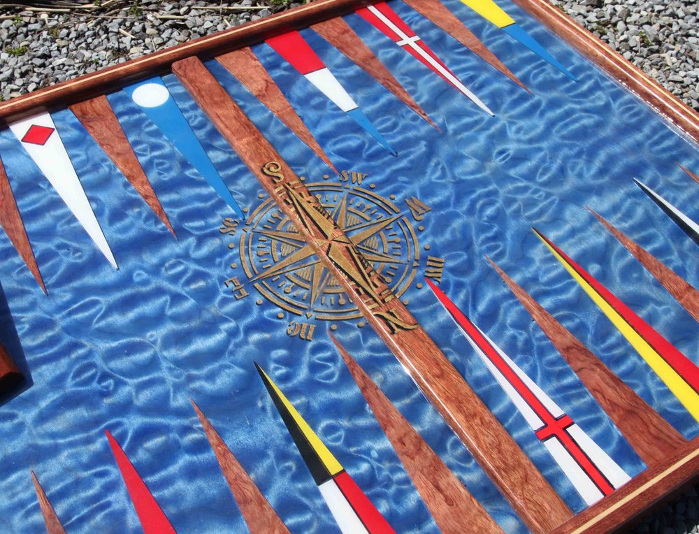 """""""Newport"""" Backgammon Board. Truly luxurious board. With georgous African Rosewood inset with maple. The playing base looks like a beautiful ocean, with a rare and special figured wood that undulates. Right at home on a boat or in the home of a yachtsman."""