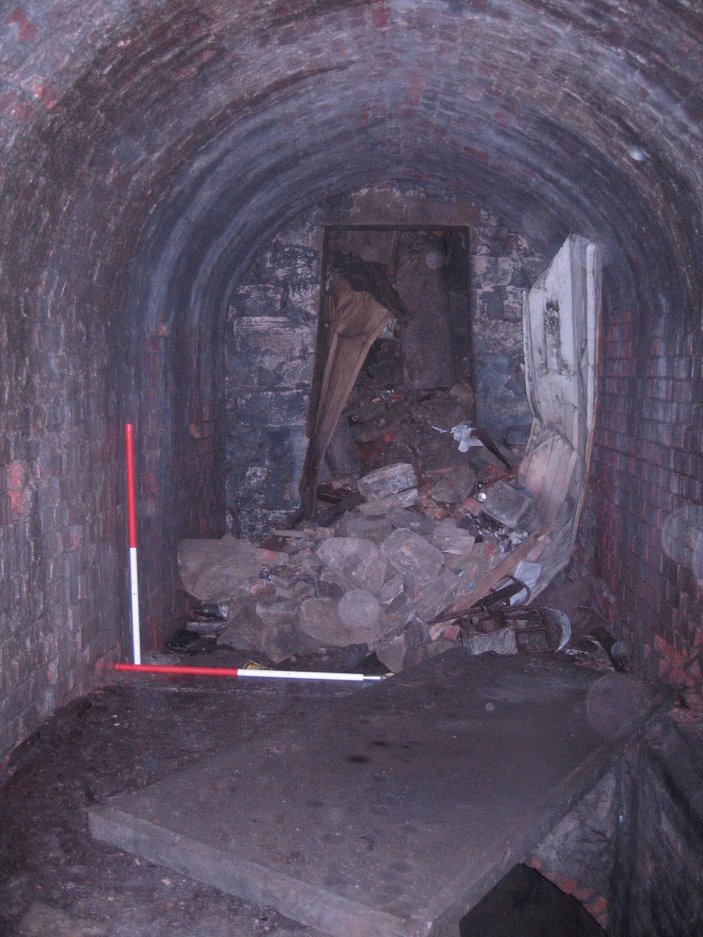 20 - S end of passage, open slab to lower vault.JPG