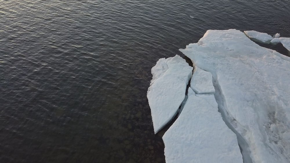 In spring, the ice starts to melt on Black Lake, Saskatchewan.