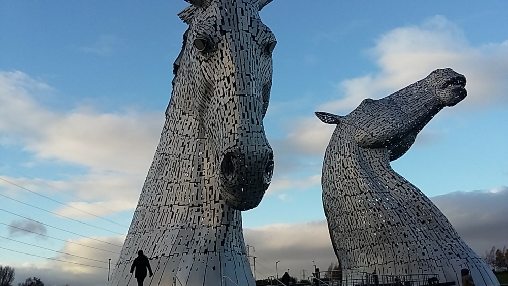 That's me in the foreground. I'm walking towards the amazing sculpture of  The Kelpies , in Falkirk, Scotland. Mind. Blown.