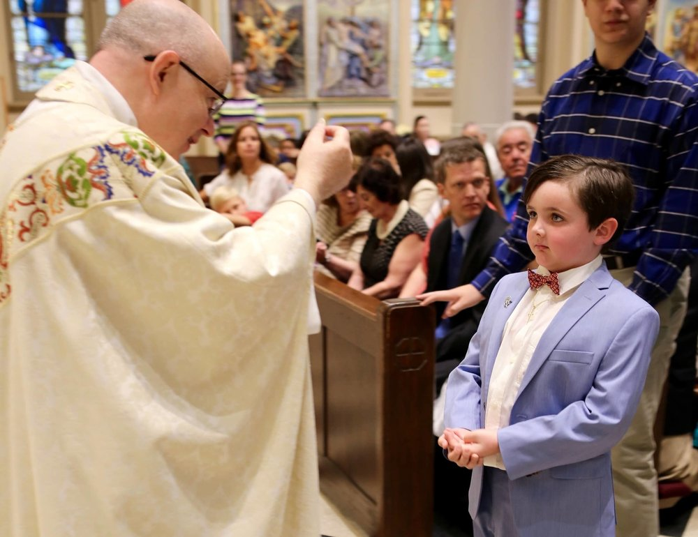 first-communion-boy-kid-suit-eucharist-st-francis-de-sales-church-new-york-city.jpg