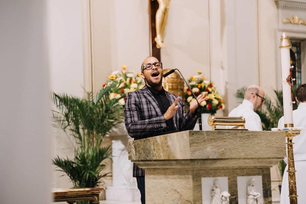 cantor-singing-clapping-jamaal-choir-mass-st-francis-de-sales-church-new-york-city.jpg