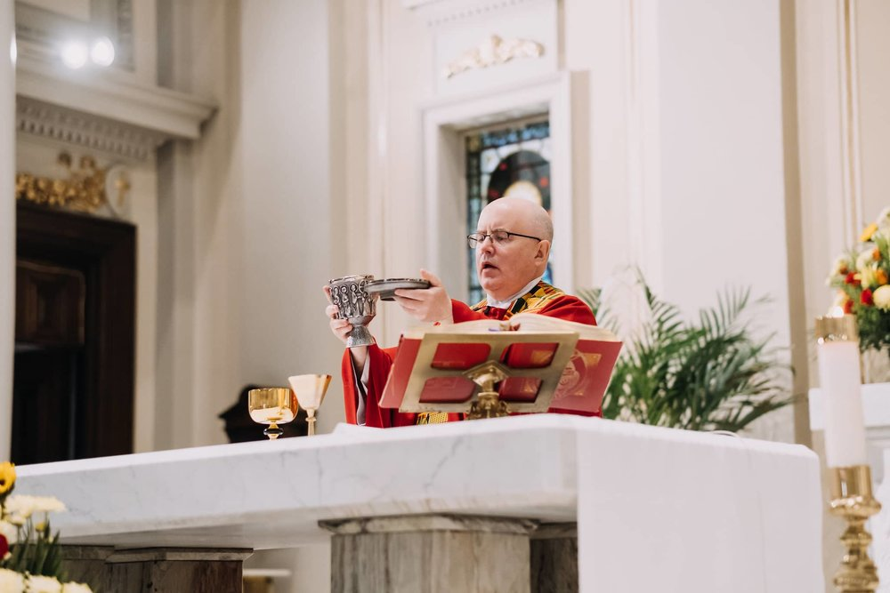 fr-kelly-eucharist-alter-mass-st-francis-de-sales-church-new-york-city.jpg