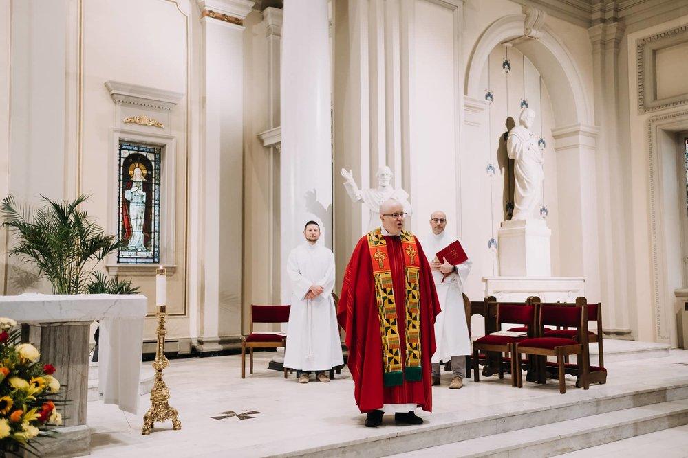 fr-phil-kelly-greeting-mass-st-francis-de-sales-church-new-york-city.jpg