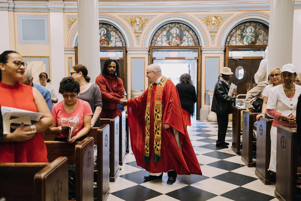 handshake-father-kelly-greeting-mass-st-francis-de-sales-church-new-york-city.jpg