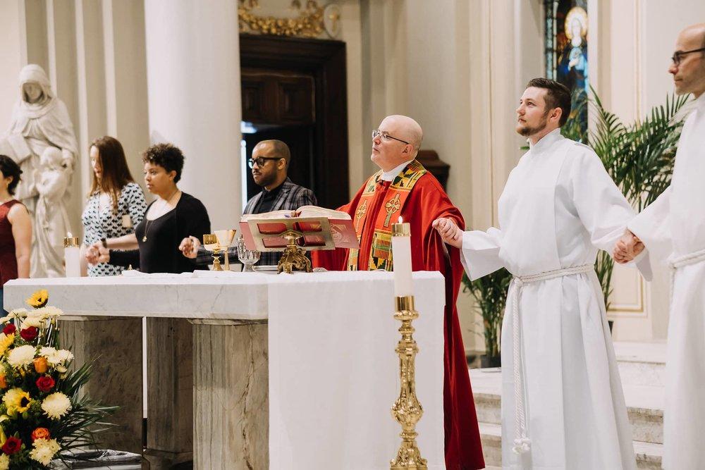 holding-hangs-community-mass-st-francis-de-sales-church-new-york-city.jpg