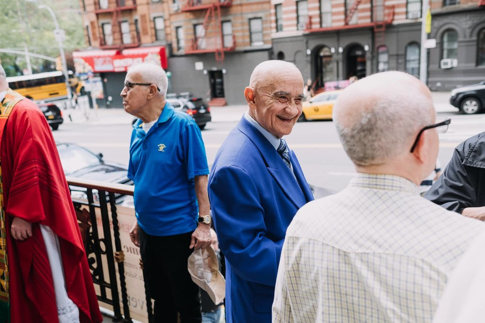 hospitality-outside-welcome-mass-st-francis-de-sales-church-new-york-city.jpg