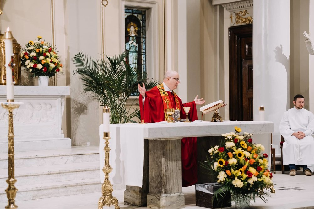 prayer-communion-blessing-fr-kelly-mass-st-francis-de-sales-church-new-york-city.jpg