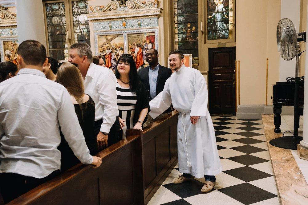 welcoming-handshake-smiles-mass-st-francis-de-sales-church-new-york-city.jpg