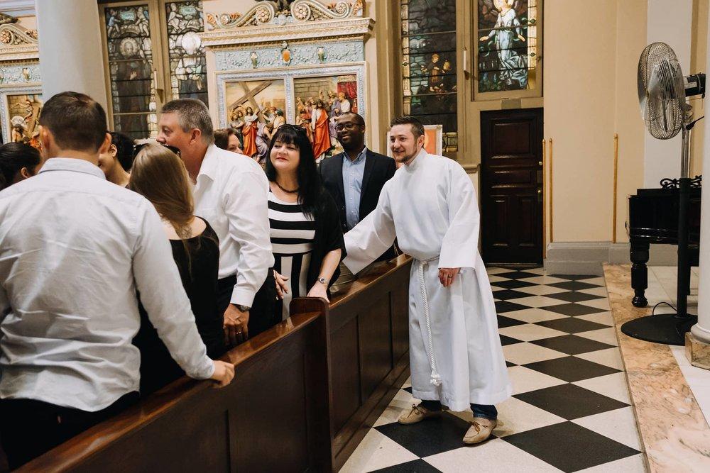 welcoming-handshake-smiles-mass-st-francis-de-sales-church-new-york-city.jpg