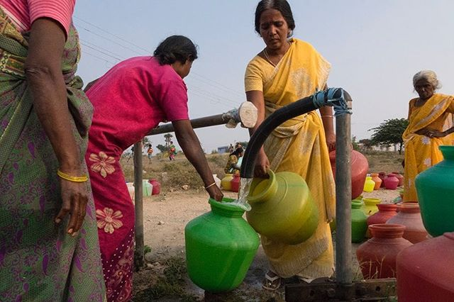 """""""Women collect cooking water from the borewell tap in Anna Nagar settlement. The tap turns on every day at 4:00 p.m. It is half a kilometre away from the settlement houses. Each house gets four pots of water."""" Photo & Caption by: Bhuvaneshwari. P @vcfindia @sony  #artforchange #water #India #studentartist #cause #sonycanada"""