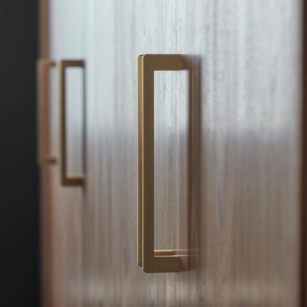 fitd-absolute-brass-handles-on-walnut-wardrobe-doors.jpg