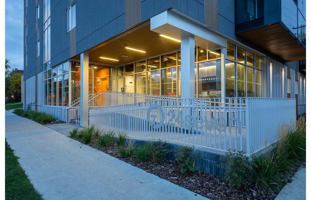 24Seven Condominium, photo of exterior front entrance at dusk / Photo:  Lindsay Reid