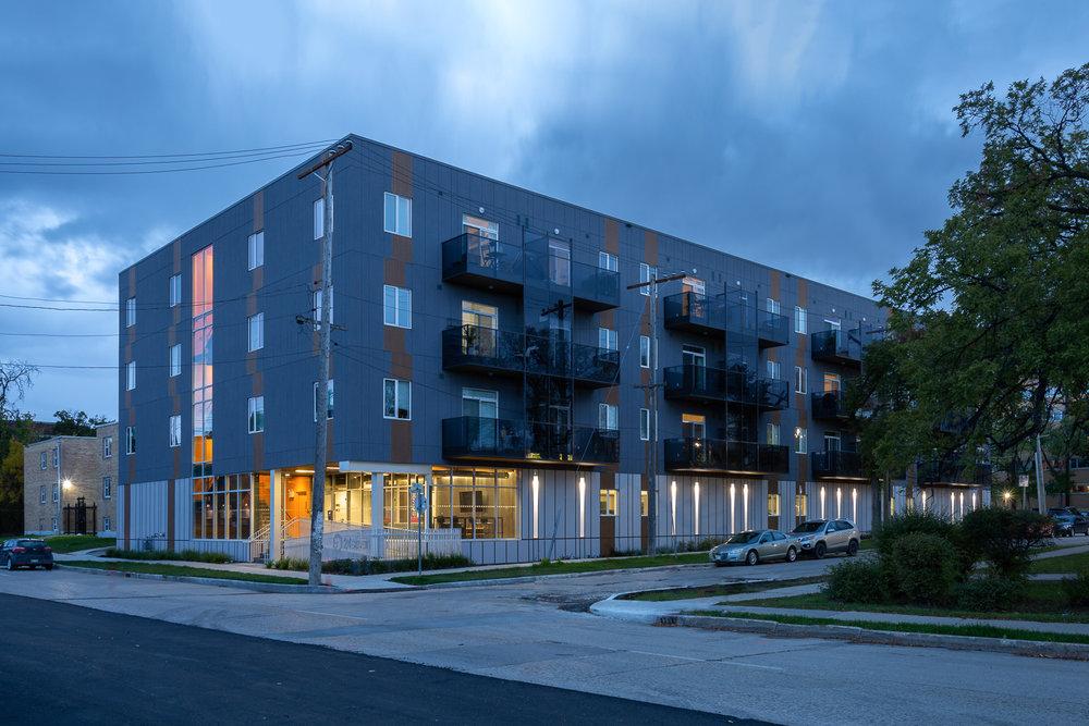 24Seven Condominiums, exterior photo of the building at dusk / Photo:  Lindsay Reid