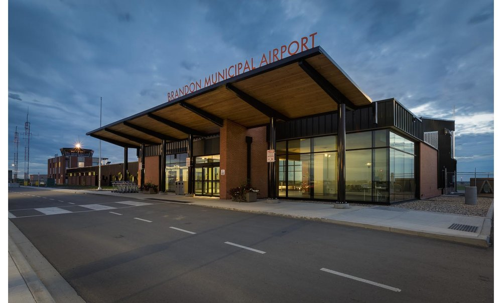 Brandon Municipal Airport, exterior photo of building at dusk / Photo:  Lindsay Reid