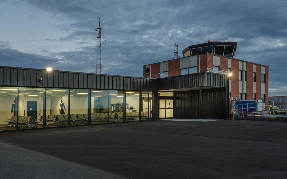 Brandon Municipal Airport, exterior photo of Departures Lounge at dusk / Photo:  Lindsay Reid